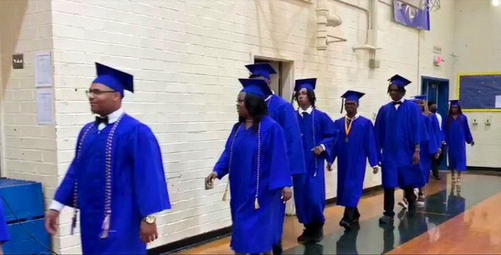 Calhoun Falls Charter graduates walking in the gymnasium