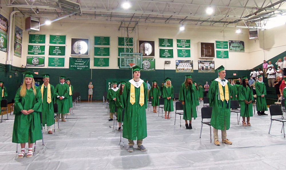 Dixie High School graduation was held in two installments Thursday evening, and the members of the Class of 2020 were separated with an eye to social distancing on the gym floor before the program began.
