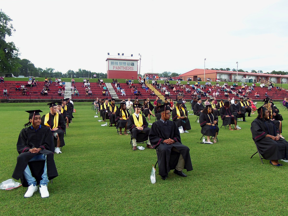Members of the AHS Class of 2020 sat in evenly spaced chairs on the football field at Abbeville High for the 2020 graduation program.