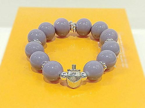 Purple ceramic beaded plated silver strawberry strand bracelet