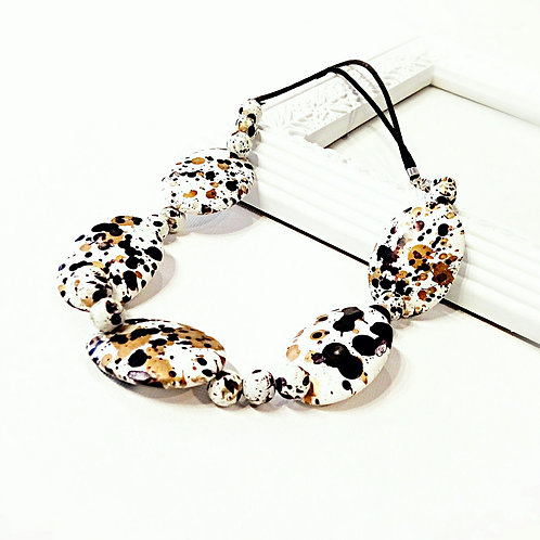 Unusual tortoise black white beaded cotton necklace