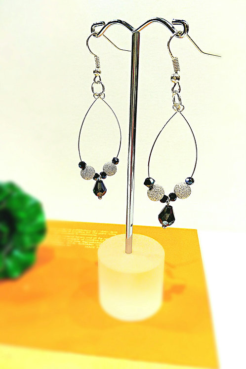 Rhombic frosted silver black drip crystal element earrings