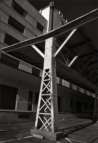 b+w tri-tone photograph of flying v roof support on mare island naval shipyard by bay area fine art photographer scott lockwood.