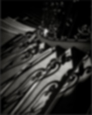 ORNATE, BANISTER SHADOWS ON STAIRWAY - B&W photograph by fine art photographer Scott Lockwood of the Pasadena City Hall staircase.