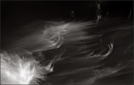 SCRATCHING AN ITCH - B+W photo by fine art photographer Scott Lockwood of wind swept clouds.
