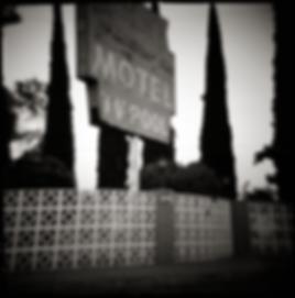 1950s MOTEL SIGN - B+W, toy-camera photograph by fine art photographer Scott Lockwood of the Famoso Motel.
