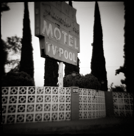 1950s MOTEL SIGN - B+W, toy-camera photograph by fine art photographer Scott Lockwood of the Famoso Motel.