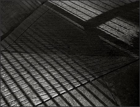 ABSTRACT SHADOW PATTERNS ON SIDEWALK - B&W photograph by fine art photographer Scott Lockwood.