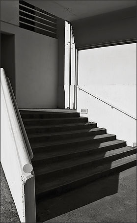 b+w tri-tone photograph of staircase graphics on mare island naval shipyard by bay area fine art photographer scott lockwood.