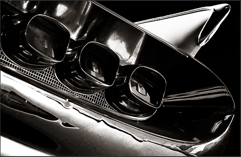 b+w tri-tone photograph of tail lights and fins of a 1959 lincoln continental by bay area fine art photographer scott lockwood.