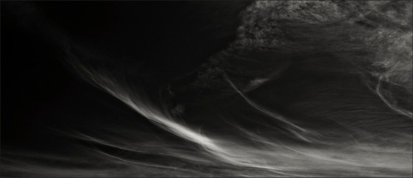 ESCAPING THE MUNDANE - B+W photo by fine art photographer Scott Lockwood of wind swept clouds.