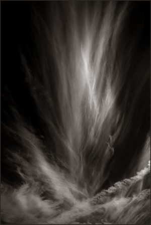 COMING TO CONCLUSIONS - B+W photo by fine art photographer Scott Lockwood of wind swept clouds.