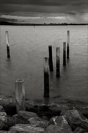 IT'S RAINING OVER IN OAKLAND - B+W photo of S.F. Bay with rain in the sky over Oakland by fine art photographer Scott Lockwood.
