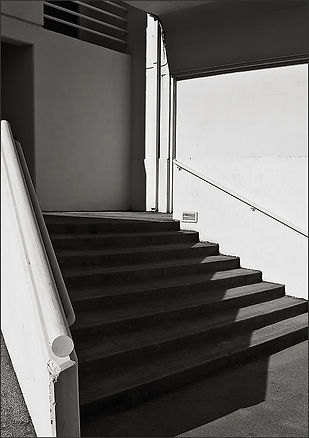B&W abstract photo of stair shadows and repeating line shapes