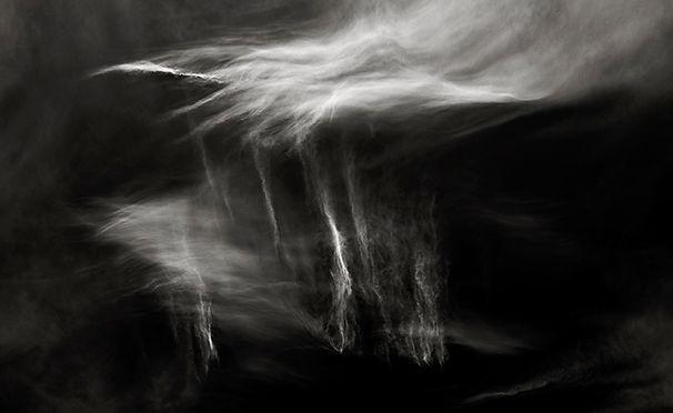 HEAVENLY HEALING - B+W photo by fine art photographer Scott Lockwood of wind swept clouds.