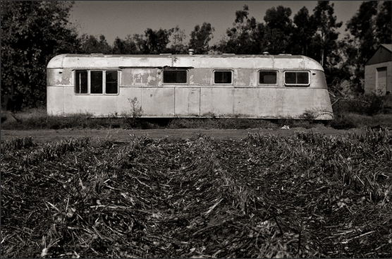 HOME IS WHERE YOU PARK IT - B+W photograph of a 1941 Kozy Coach travel trailer, by S.F. Bay Area, fine art photographer, Scott Lockwood, left abandoned in Fresno, CA field.
