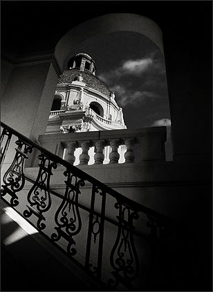 ARCHITECTURAL DETAILS  No.1 - Dramatic, B&W photograph of the dome of the Mediterranean Revival style Pasadena City Hall building from a low angle that includes three balustrades and an ornate, iron railing with the dome itself framed by an arched window. Photographed by S.F. Bay Area, fine art photographer Scott.
