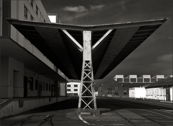 b+w tri-tone photograph of flying v roof structure on mare island naval shipyard by bay area fine art photographer scott lockwood.