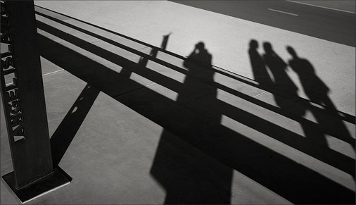 VIEWING ANGEL ISLAND - Dramatic, b+w photo, by fine art photographer Scott Lockwood, of geometric shadows projecting down across long, horizontal stairs.