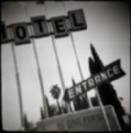 FAMOSO MOTEL-ENTRANCE SIGN - B+W, toy-camera photograph by fine art photographer Scott Lockwood of the entrance sign of the Famoso Motel.