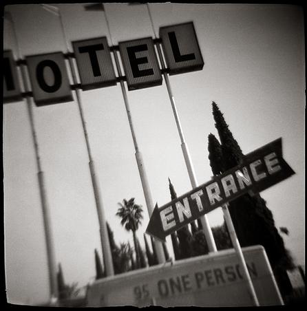 FAMOSO MOTEL-ENTRANCE SIGN - B+W, toy-camera photograph by fine art photographer Scott Lockwood of the entrance sign of the Famoso Motel.