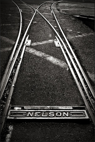 NELSON R.R. PLAQUE - Dramatic, B+W photo by fine art photographer Scott Lockwood of Nelson railroad plaque.