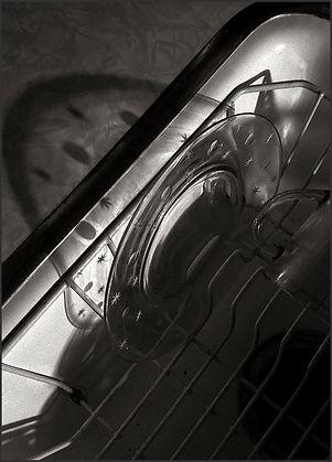 SAUCER SHADOWS - B&W photo by fine art photographer Scott Lockwood of clear, glass, saucer shadow patterns.