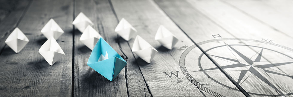 Blue-Paper-Boat-Leading-A-Fleet-Of-Small