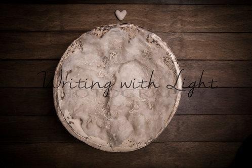 Cream bowl on wood
