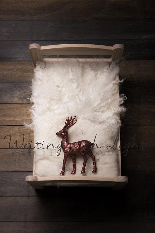 Rustic bed with reindeer