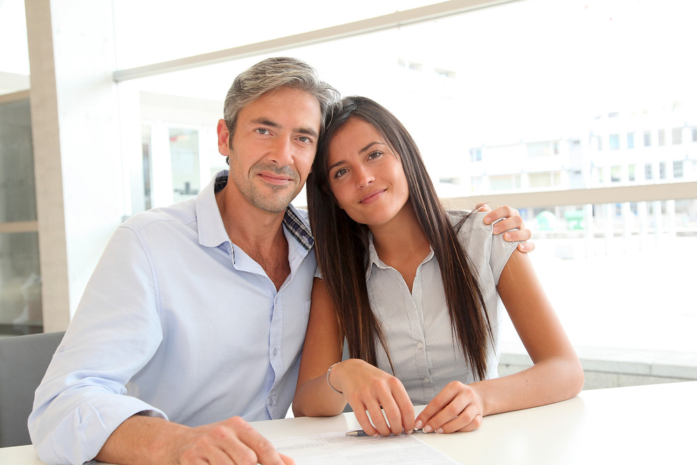 Doting Dad and College Aged Daughter - image courtesy of iStock