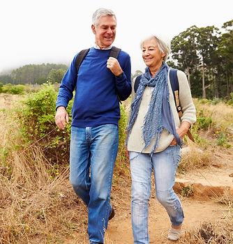 Man and woman hiking healthy fit
