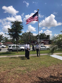 Dedication of the Dundee Area Chamber's new Flag Pole. The ceremony was performed by the VFW Post 4289 Honor Guard. Rayl Engineering & Surveying, LLC was glad to be a sponsor to help the Dundee Chamber raise funds for the new flag and pole.