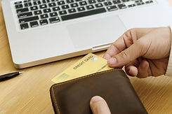 Man picking credit card in wallet for sh