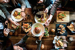 group-friends-eating-together_53876-9934