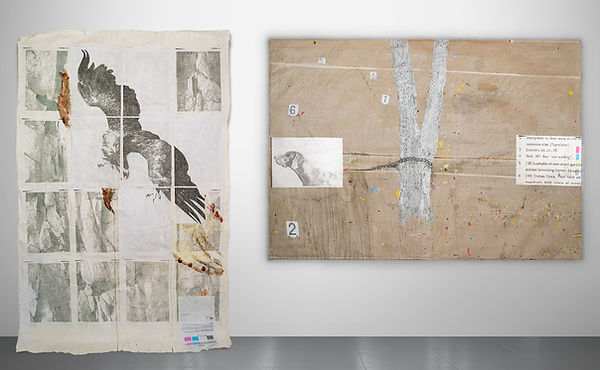 exhibition view of 2 painting. the right image shows an eagle over rock, the left image shows a hunting dog chained to a tree. Collage, handmade paint, recycled printer ink, pencil