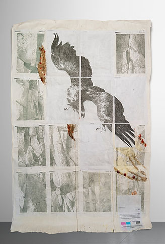 exhibition view of a painting showing an eagle over rocks. Collage, handmade paint, recycled printer ink, pencil