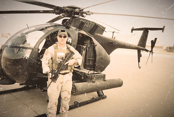 CW4 Greg Coker in Iraq in front of his AH-6 Little Bird e
