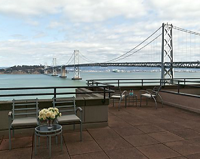 Exterior view of expansive patio and stunning view of the Bay Bridge