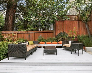 Exterior view of private landscaped backyard with wooden deck
