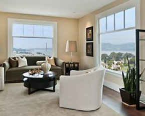 Interior view of living room with large windows overlooking the Bay and Golden Gate Bridge