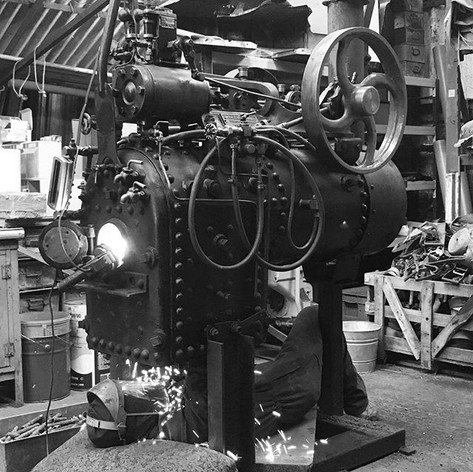 Grinding the ends off the boiler tubes before knocking them out.jpg