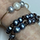 Thumbnail: 3 pearl gold filled  bangle with 1 white and 2 grey pearls.