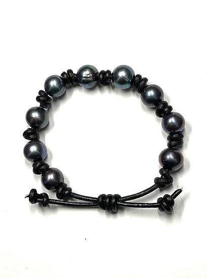 Black pearls on black leather bracelet