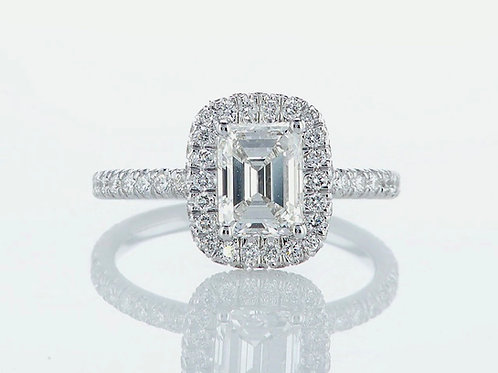 18 karat gold ring set with an emerald cut diamond