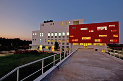 Factory administrative building at twilight, from the bridge