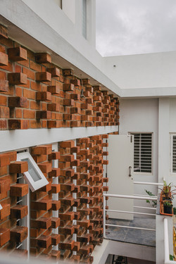 Projecting bricks of the courtyard wall seen from a bedroom