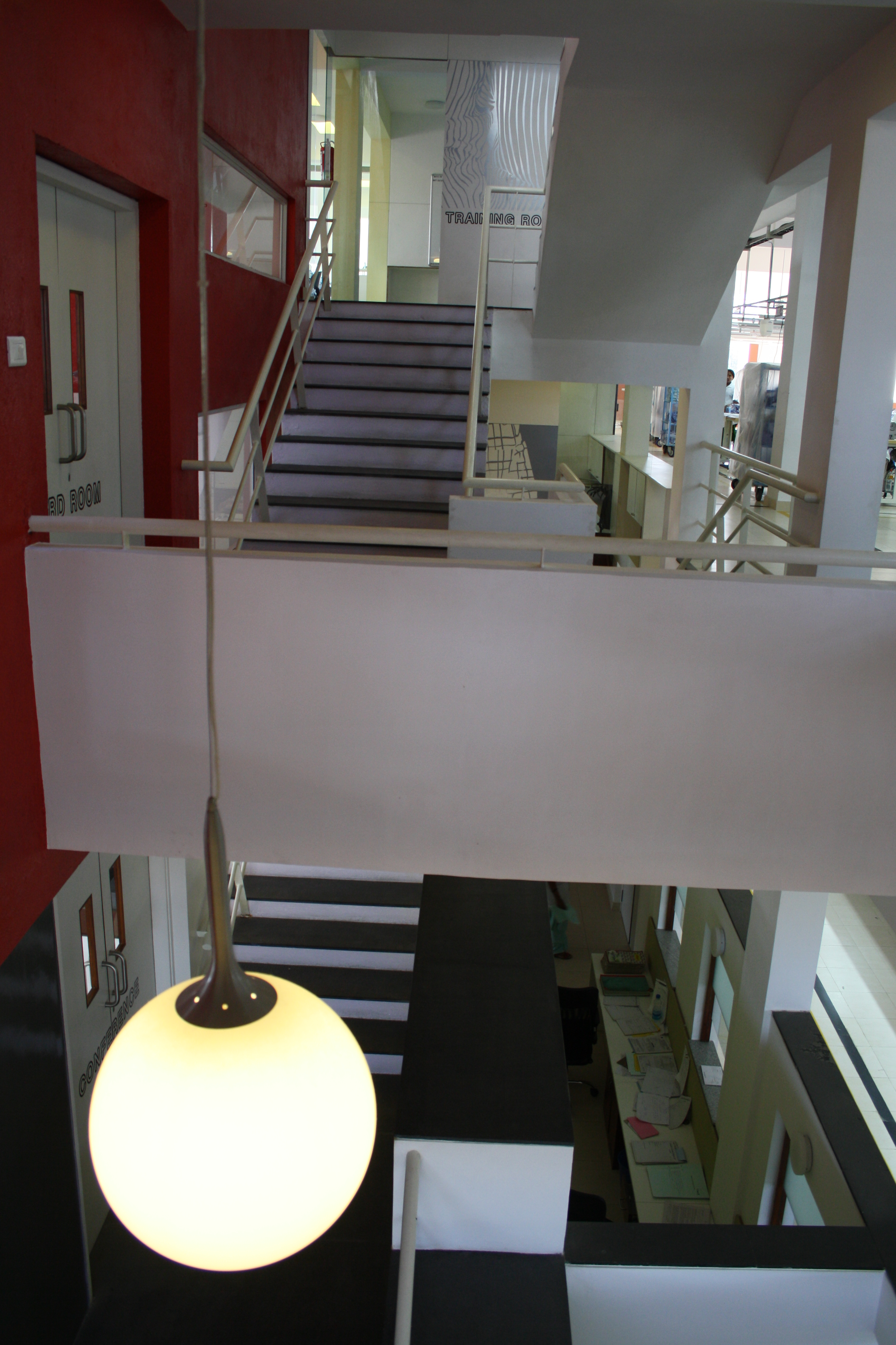 Staircase sandwiched between the boardroom and the factory floor