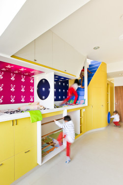 Children's bunk beds with access to the first floor play area