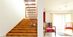 Staircase with the living room beside it
